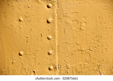Rusty iron wall covered with paint
