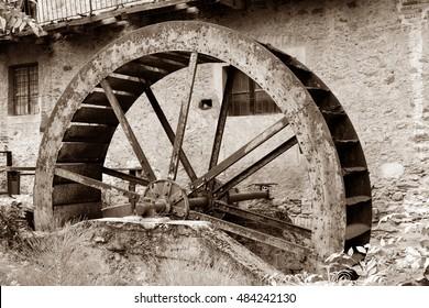 Rusty iron wheel of old mill water ,  Piedmont, Italy