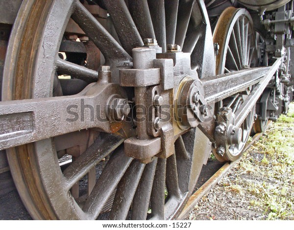 The rusty iron wheels of an old locomotive