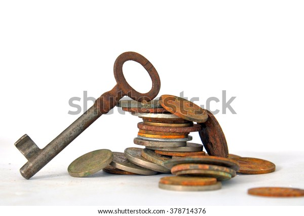rusty key on rusty coins. money concept