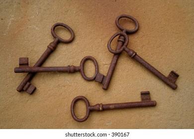 Rusty keys on the floor of stone