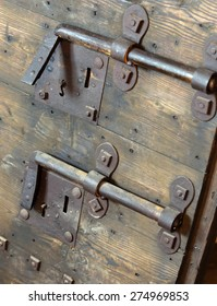 rusty lock with big deadbolt to close the door of the castle