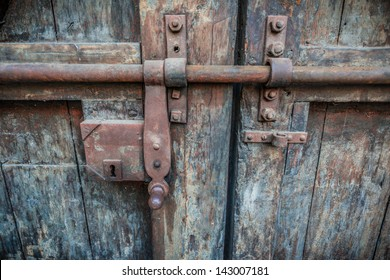 Rusty lock of old gates of Buonconsiglio castle in Trento, Trentino, Italy- details of the internal gate.