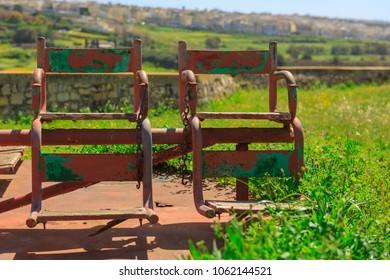A rusty merry-go-round in Mtarfa Malta
