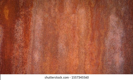 Rusty metal background with streaks of rust. Rust stains. Rysty corrosion. rust on old metal background