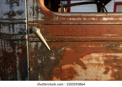 rusty metal details on side of antique truck