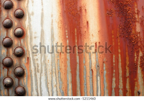 Rusty metal with large rivets