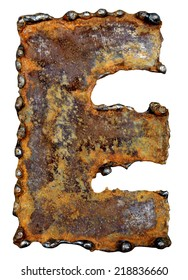 Rusty metal letter E. Old metal alphabet isolated on white background.