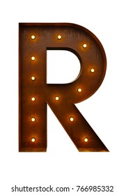 Rusty metal letter R with led light bulbs isolated on white background.