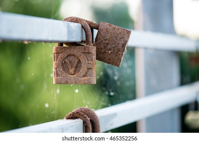 rusty metal locks on the bridge with blur background