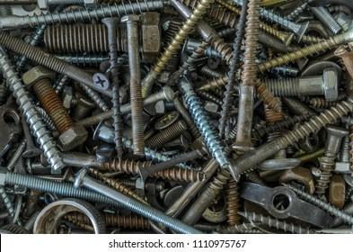 Rusty metal nails, screws, nuts, dowels, washers