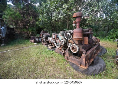 Rusty metal old machine in  outdoor ,old factory had a lot of rusty machinery many years ago,Texture of rusty machine on ground.The old Mine's old  machinery ,vale,gear,pipe and drive have rusty.