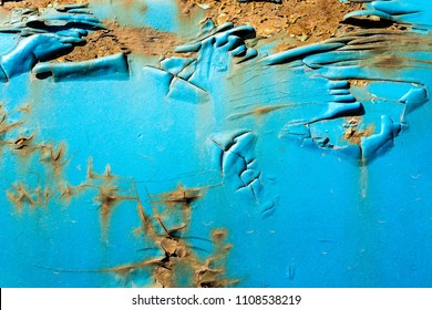 Rusty metal. The old wall. Diffused paint. Blue color.