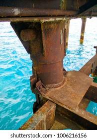 Rusty metal pier support