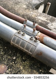 rusty metal pipes on cement floor