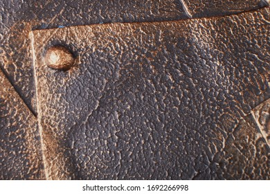 Rusty metal sheet wall with three borders of metal spikes, with orange and brown scratches and scuffs. Suitable for Wallpaper or background or grunge texture.Steampunk texture, background with mechani