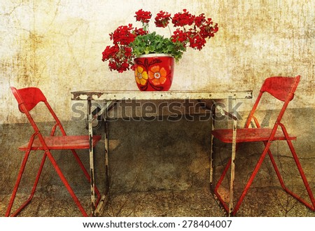 Rusty metal table with red chairs, with vintage texture applied