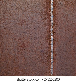 Rusty metal texture background with a weld seam.