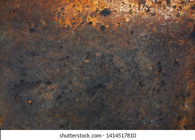 Rusty metal textured background, top view