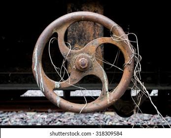 rusty metal valve,Industrial Valve Wheel,rusty valve with weed