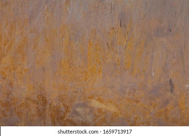 A rusty metal wall placed in an external house wall.