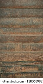 rusty metal wall with planks