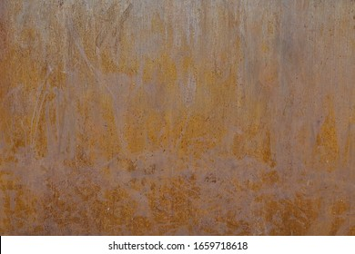 A rusty metal wall, water and time ruined it and coloured it with red tones.