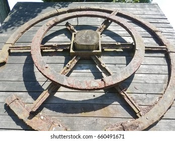 rusty metal wheel on wood