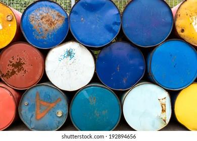 Rusty metall barrels in a row
