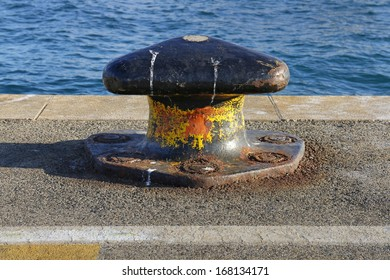 Rusty mooring bollard on a pier in Split harbor in Croatia