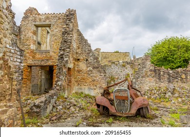 A rusty motorcar in Oradour-sur-Glane, Limousin, France, where the village was burned and its inhabitants murdered by the Nazis on 10 June 1944.