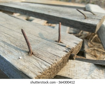 rusty nail on crack wood