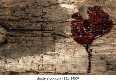 rusty nail on wood with blood drips