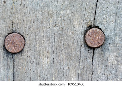 rusty nails on old wooden texture background