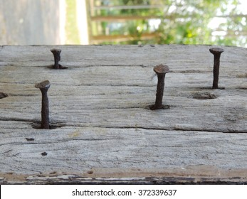 rusty nails in wood.