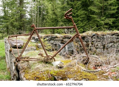 Rusty old bike frame in the ruins of an old house