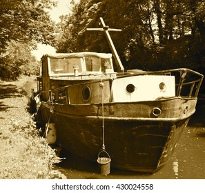 Rusty old boat on the Leeds LIverpool Canal, Adlington, Chorley, Lancashire, United Kingdom