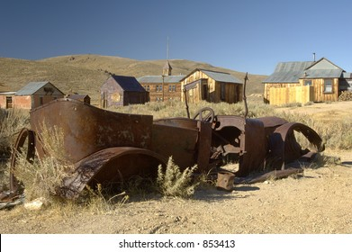 Rusty old car in a ghost town in California.