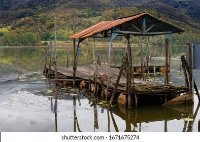 Rusty old dock by Simon Lake Italy
