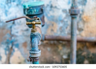 Rusty old faucets and piping system in Cuban backyard. Most households in Cuba suffer from faulty faucets and or lack of water