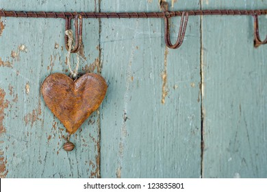 Rusty old heart on wooden rustic green background