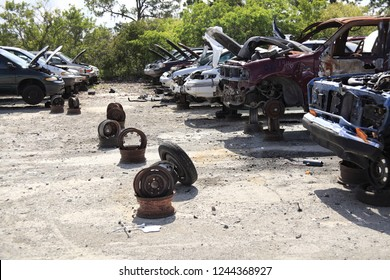 Rusty old junk cars in a row at junkyard