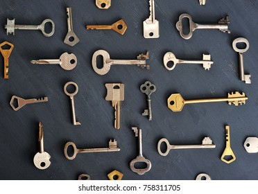 rusty old keys locks - on dark wooden rustic background - top view