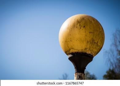 rusty old lantern post to illuminate the road