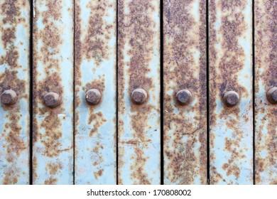 Rusty old light blue gate.
