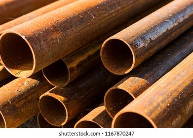 rusty old long metal pipe