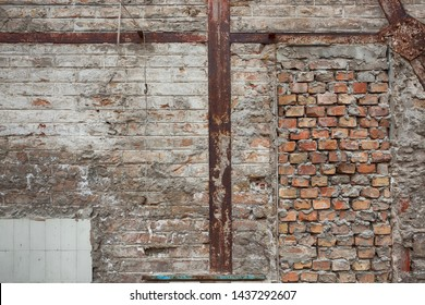 Rusty and old metal beams support system for brick wall - texture background - brick filled door hole