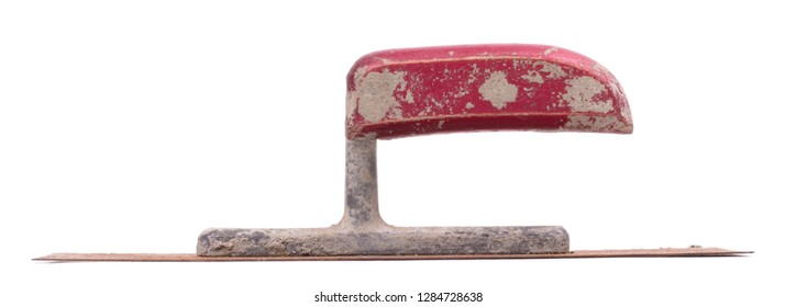 Rusty old notched trowel isolated on white