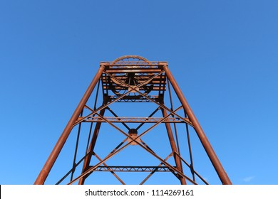 a rusty old poppet head structure left over from the gold mining days