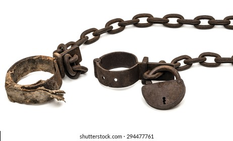Rusty old shackles with padlock and padded shackles used for locking up prisoners or slaves between 1600 and 1800.